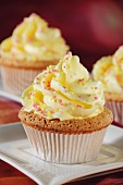 Cupcakes with yellow frosting and sugar sprinkles