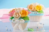 Cupcakes decorated with marzipan flowers
