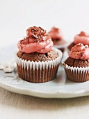 Chocolate cupcakes decorated with raspberry buttercream