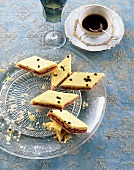 Harlequin biscuits and coffee