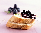 Baguette topped with blueberry and thyme preserve