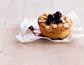 A blueberry muffin with lemongrass and slivered almonds