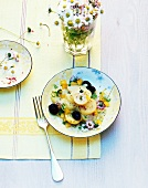 Potato salad with olives and daisies