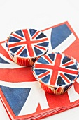 Two Union Jack cupcakes on matching paper napkins