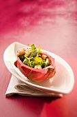 A prawn salad with dragonfruit in a hollowed out dragonfruit