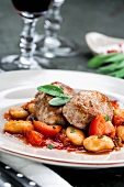 Pork fillet on a bean and tomato medley