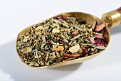 Herbal tea on a brass scoop