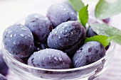 Damsons in a glass bowl