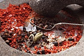 Roughly ground spices in a stone mortar