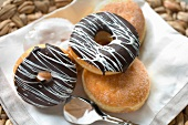 Sugared doughnuts and ring doughnuts with chocolate glaze