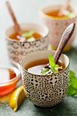 Fresh peppermint tea in mugs