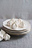 Meringues on a stack of plates