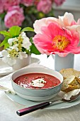 Beetroot soup with sour cream and bread