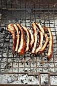 Barbecued, marinated pork ribs (honey & soy marinade)