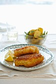 Fish fillet with parmesan crust and a side of potatoes
