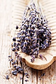 Lavender flowers in a wooden dish