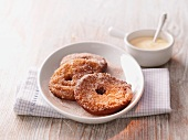 Apple cakes with cinnamon sugar and vanilla sauce