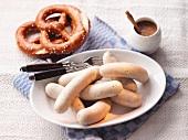White sausage, mustard and pretzels