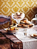 Chocolate and caramel macaroons in old-fashioned sundae glasses