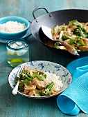 Satay chicken with broccoli and rice