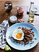 Pigs ears with chilli, lime and fried egg (USA)