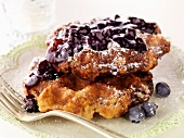 Liege Waffles with Blueberry Sauce on a Plate with a Fork