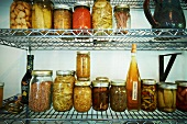 Various Pickles, Jams, and Preserved Food on Wire Shelves