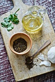 A spice mixture, garlic, coriander and olive oil