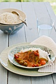 Fish with olive sauce and rice