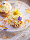 Cupcakes decorated with flower petals
