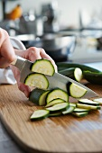 Courgette being sliced