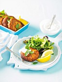 Spicy salmon and potato cakes with a mixed leaf salad