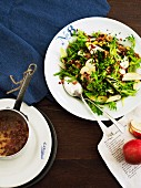 Frisee and chicory salad with apple served with a bacon dressing