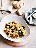 Roasted squash tortellini with amaretti, sage and onions