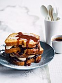 French Toast with bananas, chocolate and caramel sauce