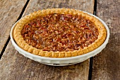 Whole Pecan Pie on a Rustic Wooden Table