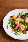 Scallop and Citrus Salad with Avocado, Micro Greens and Orange and Grapefruit Sections; On a White Plate