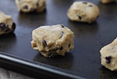 Unbaked Balls of Chocolate Chip Cookie Dough on a Pan Ready to be Baked
