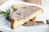 Homemade Duck and Mushroom Pate Spread on a Piece of Toast