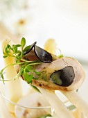 Vegetable salad with edible shoots, chicken breast and truffles