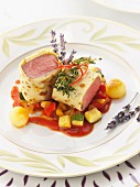 Poached lamb fillets wrapped in pancake with a vegetable ragout