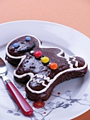 A chocolate gingerbread man decorated with chocolate beans (Christmas)