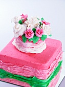 A romantic pink cake decorated with sugar roses