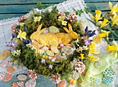 An Easter wreath with Easter bunnies, Easter eggs, Easter biscuits and daffodils