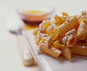 Penne with tomato sauce, ricotta and pine nuts