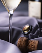 A champagne flute and a champagne cork