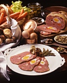 Sliced galantine with eggs, mushrooms and pistachios