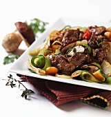Beef steak with porcini mushrooms and grilled vegetables