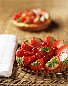 Strawberry tartlets with redcurrants