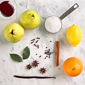Ingredients for Poaching Quince; Quince, Cinnamon, Orange, Lemon, Sugar, Vanilla, Clove, Star Anise, Bay Leaves, and Red Wine